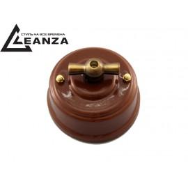 Выключатель фарфоровый поворотный одноклавишный, цвет bruno (коричневый), ручка бронза
