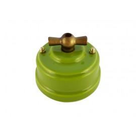Выключатель (переключатель) фарфоровый поворотный одноклавишный проходной, цвет pistacchio (фисташковый), ручка бронза