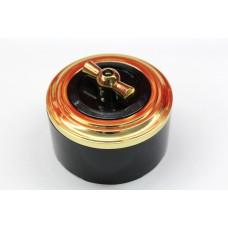 Пластиковый поворотный выключатель одноклавишный (черный механизм, золотая рамка, черный стакан, рычаг золото)