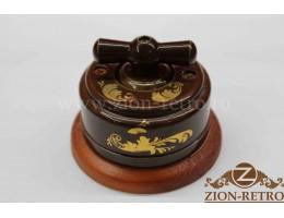 Выключатель двухклавишный с керамической ручкой бантик, «Магия золота», подрозетник вишня