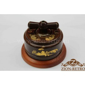 Выключатель одноклавишный (проходной) с керамической ручкой бантик, «Магия золота», подрозетник вишня