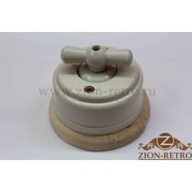 Выключатель одноклавишный (проходной) с керамической ручкой бантик, «Слоновая кость», подрозетник береза