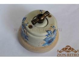 Выключатель одноклавишный (проходной) с металлической ручкой бантик, «Лазурь», подрозетник береза