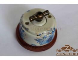 Выключатель одноклавишный (проходной) с металлической ручкой бантик, «Лазурь», подрозетник вишня