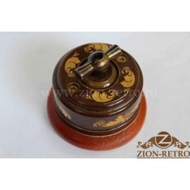 Выключатель одноклавишный (проходной) с металлической ручкой бантик, «Магия Золота», подрозетник вишня