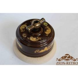 Выключатель одноклавишный (проходной) с металлической ручкой бантик, «Магия Золота», подрозетник береза