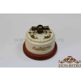 Выключатель одноклавишный (проходной) с металлической ручкой бантик, «Золото», подрозетник вишня