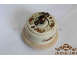 Выключатель одноклавишный (проходной) с металлической ручкой бантик, «Золото», подрозетник береза
